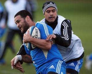 Aaron Smith (R), seen tackling Piri Weepu at an All Black training session in Edinburgh, will...