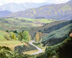Acclaimed artist Dick Frizzell, of Auckland, stands beside The Road West to Lawrence (2012), one...