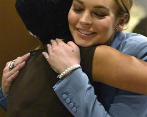 Actress Lindsay Lohan hugs her attorney Shawn Holley in this March file photo. REUTERS/Joe Klamar...