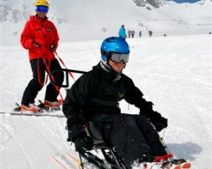 Adaptive programme co-ordinator Ross James (left) with Hans van de Boomen on the dual-ski at the...