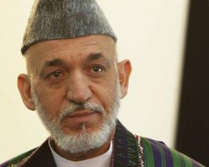 Afghan President Hamid Karzai, who labelled as 'inhuman' the actions of two US Marines who were...