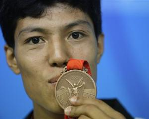 Afghanistan's Rohullah Nikpai attends a press conference with his bronze medal awarded n the men...