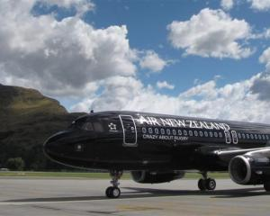 Air New Zealand continues to fly as others remain on the ground. Photo by Tracey Roxburgh.