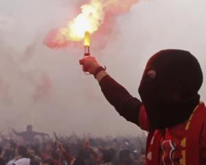 Al Ahly fans, also known as 'Ultras', celebrate and shout slogans in front of the Al Ahly club...