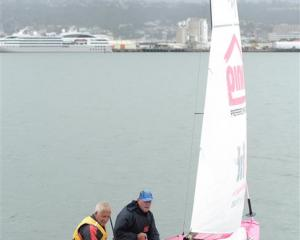Alan Potter (left) and Gordon Marr head out for a training sail on Otago Harbour yesterday before...