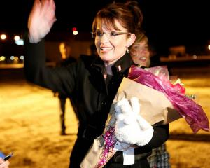 Alaska Gov. Sarah Palin greets supporters after returning to Anchorage, Alaska, on Wednesday Nov....