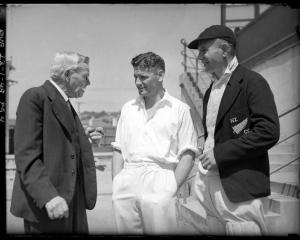 Alex Downes is congratulated by A.W. Roberts and Otago captain Lankford Smith at Carisbrook after...