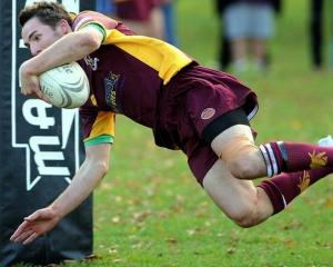 Alhambra-Union fullback Corey McFadzean scores a try during the game against Taieri at the North...
