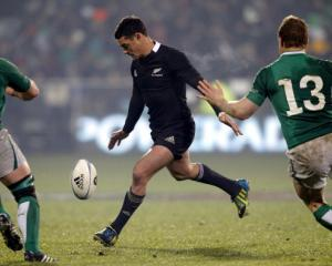 All Black first five Dan Carter kicks a drop goal during the second test against Ireland in...