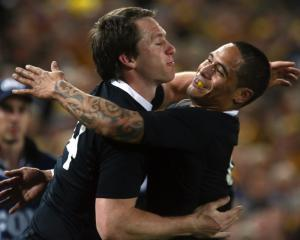 All Blacks player Ben Smith (left) celebrates with teammate Aaron Smith after scoring a try...