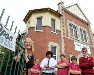 Amana Christian School principal Liz Bishop with pupils (from left) Harry Granger (12), Tim...