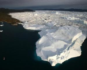An aerial view of icebergs as they float out of the Jacobshavn Fjord, Greenland, in this 2007...