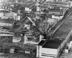 An aerial view of the Chernobyl nuclear power plant. The arrow shows the spot of the accident. A...