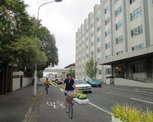 An artist's impression of a one-directional cycle lane in Cumberland St, Dunedin. Image from NZTA.