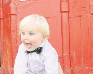 An enthusiastic young guest at the wedding of Angela Walton and Stuart Ellwood, at Outram in...