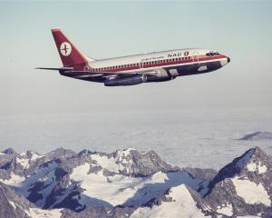 An NAC plane in its 1970s livery flies over the Southern Alps. Perhaps destined for Dunedin....