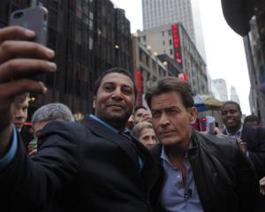 Anger Management star Charlie Sheen still has time for his fans. Photo by Reuters.