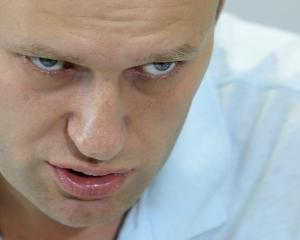 Anti-corruption blogger and opposition leader Alexei Navalny speaks during an interview with...