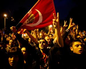 Anti-government protesters shout slogans during a demonstration in central Ankara. REUTERS/Umit...