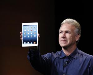 Apple senior vice president of worldwide marketing Philip Schiller introduces the new iPad mini....