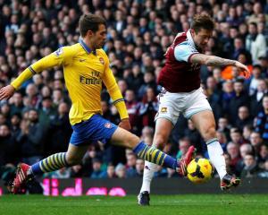 Arsenal's Aaron Ramsey (L) challenges West Ham United's George McCartney. REUTERS/Suzanne Plunkett