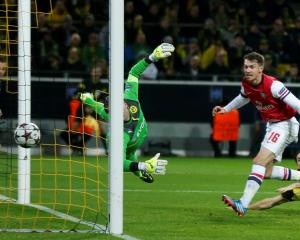 Arsenal's Aaron Ramsey (R) scores past Borussia Dortmund's goalkeeper Roman Weidenfeller. REUTERS...
