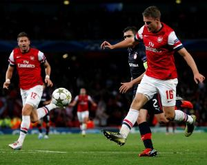 Arsenal's Aaron Ramsey scores a goal against Olympiakos Piraeus during their Champions League...