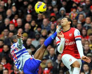 Arsenal's Andre Santos (R) and Queens Park Rangers' Shaun Wright-Phillips challenge for the ball...
