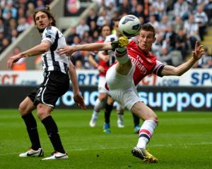 Arsenal's Lourent Koscielny (R) shoots to score against Newcastle United during their English...