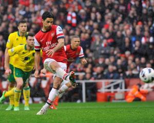 Arsenal's Mikel Arteta shoots to score against Norwich City during their English Premier League...