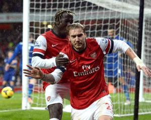 Arsenal's Nicklas Bendtner (R) celebrates his goal against Cardiff City with Bacary Sagna....