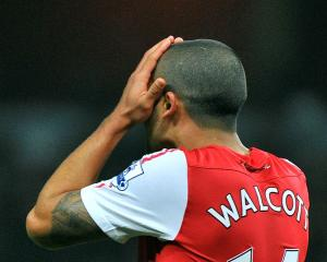 Arsenal's Theo Walcott reacts after missing a goal-scoring opportunity against Newcastle United...