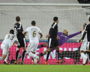 Ashley Williams scores for Swansea. Photo: Reuters