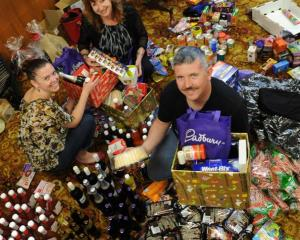 Assembling Christmas hampers for redundant Hillside workers are (from left) Simone Hourigan,...