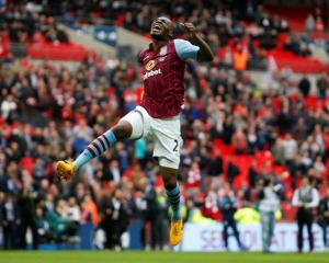 Aston Villa's Christian Benteke celebrates his side's win over Liverpool. Action Images via...
