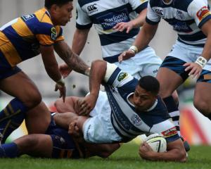 Auckland's George Moala is caught by the Bay of Plenty defence. Photo Getty