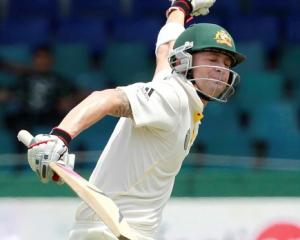 Australia captain Michael Clarke celebrates after scoring a century during the final day of their...