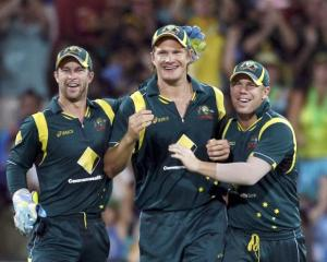 Australia's Matthew Wade (L) and David Warner congratulate stand-in captain Shane Watson (C) for...