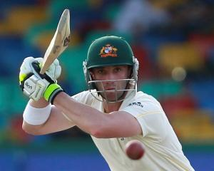 Australia's Phillip Hughes watches a shot as he works towards a century against Sri Lanka  during...