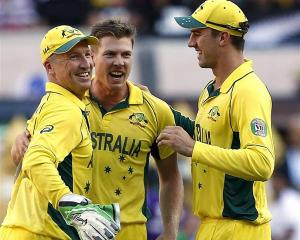 Australia's wicketkeeper Brad Haddin (L) celebrates with team-mates James Faulkner (2nd L) and...