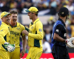 Australia wicketkeeper Brad Haddin (L) celebrates with team-mates James Faulkner (2nd L) and...