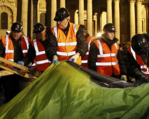 Bailiffs remove tents from the Occupy encampment in front of St Paul's Cathedral in London early...
