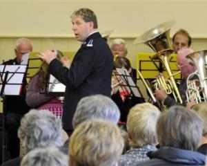 Band master Tony Hayward conducts the Salvation Army band at the Port Chalmers town hall...