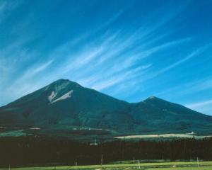 Bandai-san volcano rises to 1800m.