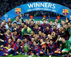 Barcelona players celebrate with the trophy after winning the Champions League final. Photo:...