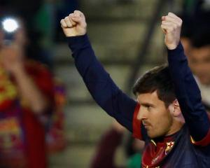 Barcelona's Lionel Messi celebrates after scoring against Real Betis during their Spanish First...