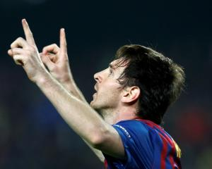 Barcelona's Lionel Messi celebrates scoring his second penalty against AC Milan during their...