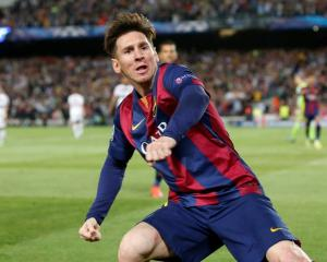 Barcelona's Lionel Messi celebrates scoring their first goal against Bayern Munich at the Nou...