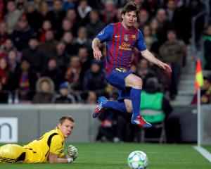 Barcelona's Lionel Messi (R) scores his fourth goal past Bayer Leverkusen's goalkeeper Bernd Leno...