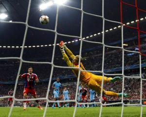 Bayern Munich's Jerome Boateng (not pictured) scores a goal past Manchester City goalkeeper Joe...